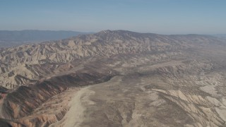 AX70_204 - 4K stock footage aerial video Passing a rugged desert mountains in the Caliente Mountain Range, California