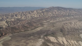 AX70_205 - 4K stock footage aerial video View of a rugged desert mountains in the Caliente Mountain Range, California
