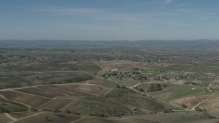 AX70_226 - Aerial stock footage of 4K Aerial Video Flyby rural homes and vineyards in Paso Robles, California