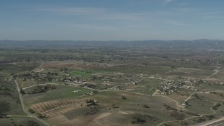 AX70_227 - Aerial stock footage of 4K Aerial Video Flyby rural homes and vineyards, reveal State Route 46 in Paso Robles, California