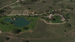 AX70_229 - Aerial stock footage of 4K Aerial Video Upscale home and a pond in Paso Robles, California