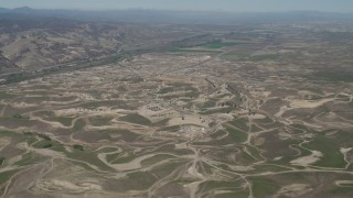 AX70_233 - 4K stock footage aerial video Approaching oil fields in San Ardo, California