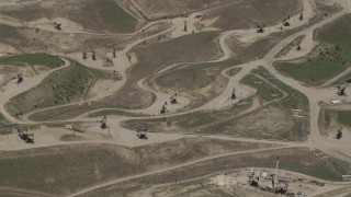 AX70_234 - 4K stock footage aerial video bird's eye view of oil rigs in a field in San Ardo, California