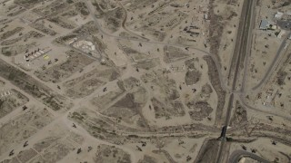 AX70_238 - 4K stock footage aerial video Bird's eye of rigs in an oil field in San Ardo, California