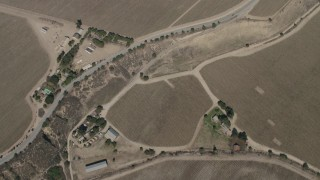 AX70_249 - 4K stock footage aerial video bird's eye view of crop fields around Arroyo Seco Road in Greenfield, California