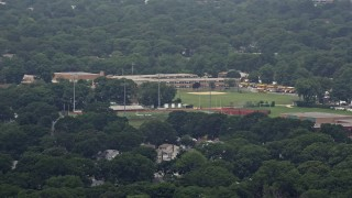 AX71_004 - 5K stock footage aerial video flying by Seaford High School and football fields, Seaford, Long Island, New York