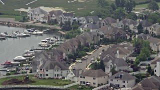 AX71_006 - 5K stock footage aerial video flying by waterfront homes beside a canal, Seaford, Long Island, New York
