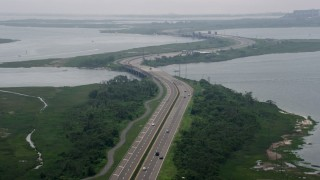 AX71_008 - 5K stock footage aerial video of Wantagh State Parkway on a foggy day, Long Island, New York
