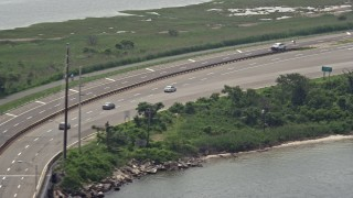 AX71_009 - 5K stock footage aerial video tracking a sedan on Wantagh State Parkway, Long Island, New York