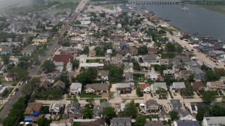 AX71_020 - 5K stock footage aerial video flying over a seaside neighborhood in Point Lookout, Long Island, New York