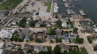 AX71_021 - 5K stock footage aerial video flying over small marina, Loop Parkway in Point Lookout, Long Island, New York
