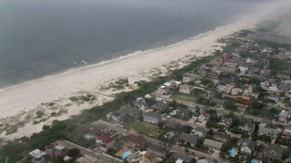 AX71_023 - 5K stock footage aerial video flying by Lido Beach and beachfront homes, Long Island, New York