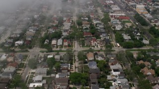 AX71_025 - 5K stock footage aerial video of low fog over suburban neighborhoods in Lido Beach, Long Island, New York