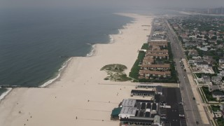 AX71_028 - 5K stock footage aerial video flying over condominiums and New Plaza Beach Club on Atlantic Beach, Long Island, New York