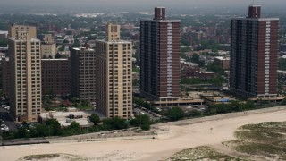 AX71_031 - 5K stock footage aerial video flying by beachfront apartment buildings in Far Rockaway, Queens, New York