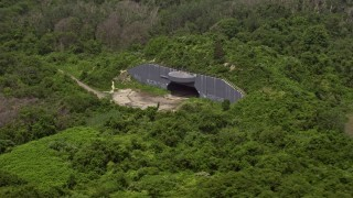 AX71_040 - 5K stock footage aerial video flying past a casemate in Fort Tilden, Queens, New York