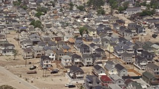 AX71_041E - 5K stock footage aerial video flying past beachfront homes in Breezy Point, Queens, New York