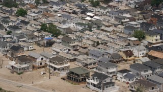 AX71_042 - 5K stock footage aerial video flying past beach homes in Breezy Point, Queens, New York