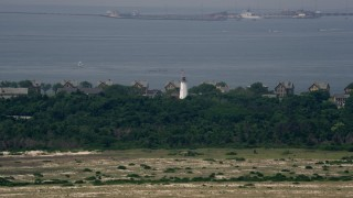 AX71_048 - 5K stock footage aerial video flying past Sandy Hook Lighthouse and waterfront homes in Middletown, New Jersey