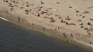 AX71_049 - 5K stock footage aerial video of sunbathers on a Sandy Hook beach, Highlands, Jersey Shore