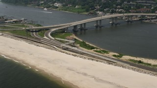AX71_051 - 5K stock footage aerial video flying past Highlands-Sea Bright Bridge spanning Highlands Reach, Jersey Shore