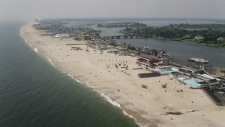 AX71_053 - 5K stock footage aerial video of sunbathers at a beach in Sea Bright, Jersey Shore, New Jersey