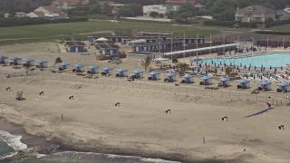 AX71_062 - 5K stock footage aerial video flying by Deal Casino Beach Club cabanas in Deal, Jersey Shore, New Jersey