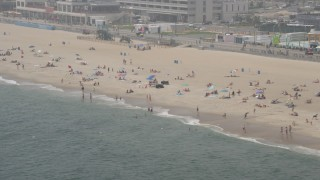 AX71_065 - 5K stock footage aerial video of sunbathers on the beach in Asbury Park, Jersey Shore, New Jersey