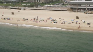 AX71_072 - 5K stock footage aerial video of beach goers on a beach in Spring Lake, Jersey Shore, New Jersey