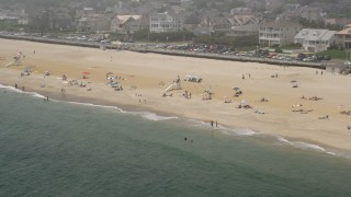 AX71_074 - 5K stock footage aerial video of sunbathers and lifeguard on the beach in Spring Lake, Jersey Shore, New Jersey