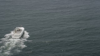 AX71_075 - 5K stock footage aerial video of a sport boat cruising on the Atlantic Ocean