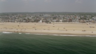 AX71_077 - 5K stock footage aerial video of sunbathers and beachfront homes in Manasquan, Jersey Shore, New Jersey