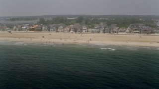 AX71_078 - 5K stock footage aerial video of sunbathers and a row of beachfront homes in Manasquan, Jersey Shore, New Jersey