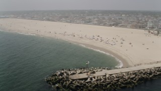 AX71_079 - 5K stock footage aerial video of sunbathers at Point Pleasant Beach, Jersey Shore, New Jersey