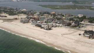 AX71_084 - 5K stock footage aerial video of beachfront homes in Mantoloking, Jersey Shore, New Jersey