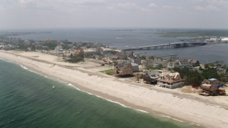 AX71_085 - 5K stock footage aerial video of beachfront homes in Mantoloking, Jersey Shore, New Jersey