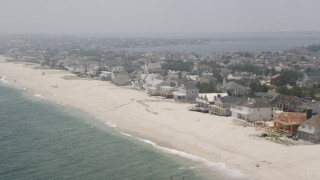 AX71_087 - 5K stock footage aerial video of beachfront property at Mantoloking, Jersey Shore, New Jersey