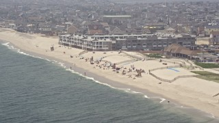 AX71_088 - 5K stock footage aerial video of sunbathers at a beach, Mantoloking, Jersey Shore, New Jersey