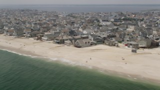 AX71_090 - 5K stock footage aerial video of beachfront properties people on the beach in Normandy Beach, Jersey Shore