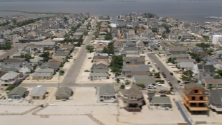 AX71_092 - 5K stock footage aerial video of beachfront homes in the coastal community of Lavallette, Jersey Shore, New Jersey