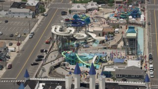 AX71_096 - 5K stock footage aerial video orbiting Breakwater Beach Waterpark, Seaside Heights, Jersey Shore, New Jersey