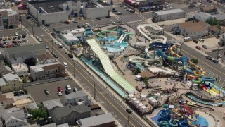 AX71_098 - 5K stock footage aerial video orbiting Breakwater Beach Waterpark and Casino Pier, Seaside Heights, Jersey Shore, New Jersey