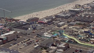 AX71_098E - 5K stock footage aerial video orbiting Breakwater Beach Waterpark and Casino Pier, Seaside Heights, Jersey Shore, New Jersey