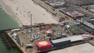 AX71_099 - 5K stock footage aerial video orbiting rides at Casino Pier amusement park by the boardwalk, Seaside Heights, Jersey Shore, New Jersey