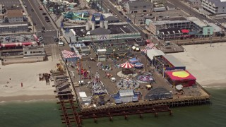AX71_100E - 5K stock footage aerial video of an amusement park on Casino Pier, Seaside Heights, Jersey Shore, New Jersey