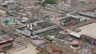 AX71_101 - 5K stock footage aerial video of Casino Pier, boardwalk, and Breakwater Beach Waterpark, Jersey Shore, New Jersey