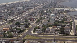 AX71_102 - 5K stock footage aerial video of neighborhoods around a water tower in Seaside Heights, Jersey Shore, New Jersey