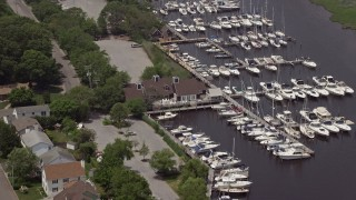 AX71_106 - 5K stock footage aerial video of Dillon's Creek Marina in Island Heights, New Jersey