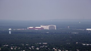 AX71_110 - 5K stock footage aerial video of Lakehurst Naval Air Station on a foggy day, New Jersey