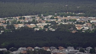 AX71_111 - 5K stock footage aerial video of the rooftops of homes in Toms River, New Jersey